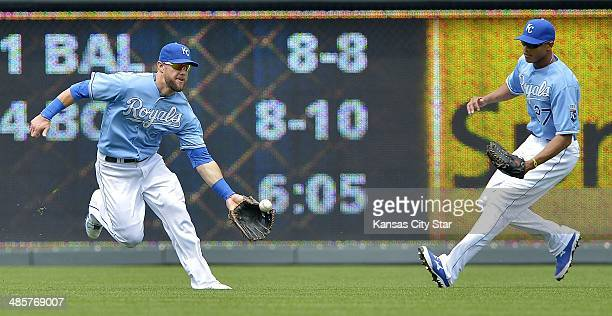 Kansas City Royals left fielder Alex Gordon chases down an RBI single in front of right fielder Justin Maxwell by the Minnesota Twins' Chris...