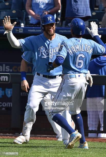 Kansas City Royals left fielder Alex Gordon congratulates Kansas City Royals center fielder Billy Hamilton after he scored the game winning run...