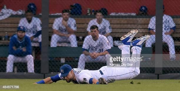 Kansas City Royals left fielder Alex Gordon traps a hit by the Texas Rangers' Ryan Rua in the second inning on Wednesday, Sept. 3 at Kauffman Stadium...