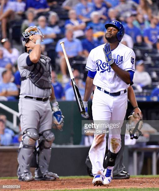 Kansas City Royals' Lorenzo Cain flips his bat after hitting an infield pop out to Tampa Bay Rays first baseman Logan Morrison in the seventh inning...