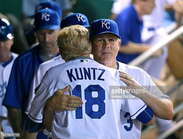 Kansas City Royals manager Ned Yost is congratulated by first base coach Rusty Kuntz after the team's 32 win against the Milwaukee Brewers on...
