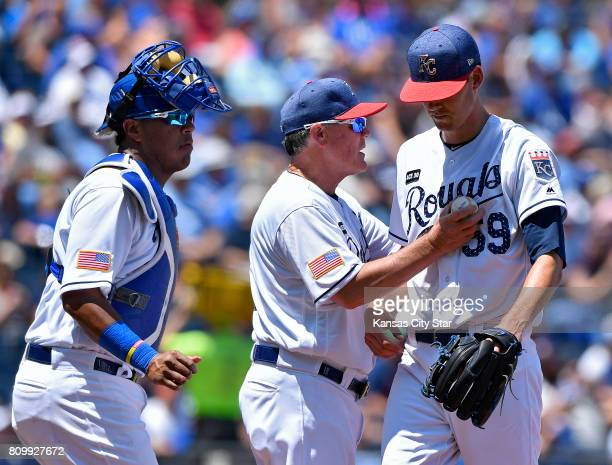 Kansas City Royals manager Ned Yost relieves starting pitcher Luke Farrell right against the Minnesota Twins at Kauffman Stadium in Kansas City Mo on...