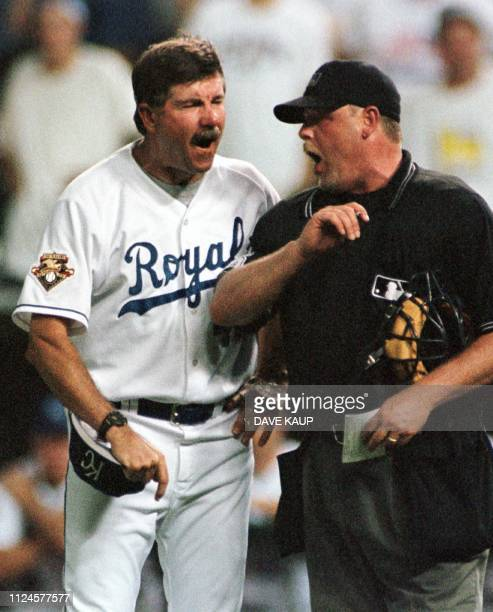 Kansas City Royals manager Tony Muser and home plate umpire Jim Joyce have an exchange following Muser's automatic ejection after relief pitcher Cory...