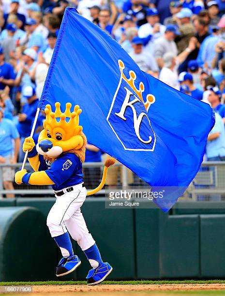 Kansas City Royals mascot Slugger carries a flag into the outfield as the Royals defeated the Minnesota Twins 3-1 to win their home opener at...