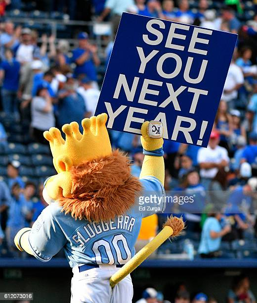 Kansas City Royals mascot Sluggerrr raises a sign hoping to see all the fans again next season after the Royals 32 loss against the Cleveland Indians...