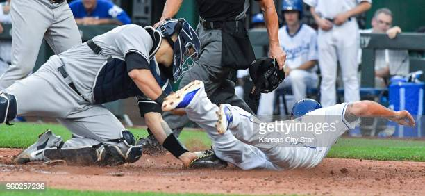 Kansas City Royals' Mike Moustakas is tagged out at the plate by New York Yankees catcher Gary Sanchez on a double by Salvador Perez to end the fifth...