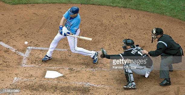 Kansas City Royals' Mitch Maier connects on a sacrifice fly that scored Billy Butler in the fourth against the Chicago White Sox, Sunday, May 16 at...