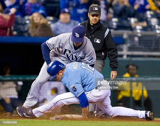 Kansas City Royals' Mitch Maier right is tagged out by Tampa Bay Rays third baseman Dan Johnson on a steal attempt in the fourth inning at Kauffman...