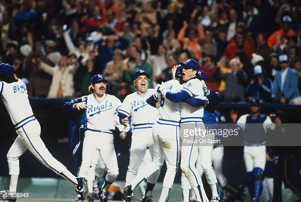 Kansas City Royals' outfielder Willie Wilson is mobbed by Willie Aikens manager Jim Frey and teammates after Aikens hit a tworun home run against the...