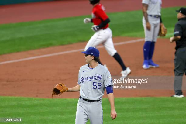 Kansas City Royals pitcher Daniel Lynch wait for a new baseball as Cleveland Indians second base Ernie Clement rounds the bases after hitting a home...