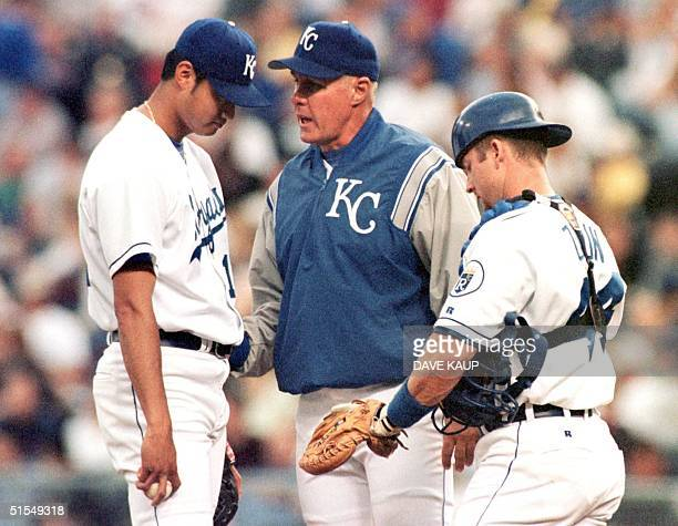 Kansas City Royals pitching coach Brent Strom tries to calm down starting pitcher Mac Suzuki during one of many mound conferences during the 16 June...