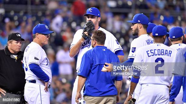 Kansas City Royals relief pitcher Brian Flynn leaves the game with an injury in the sixth inning during Monday's baseball game against the Tampa Bay...