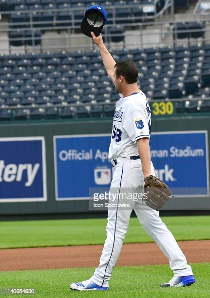 Kansas City Royals relief pitcher Jake Newberry tips his hat to Kansas City Royals center fielder Billy Hamilton after he makes a diving catch for an...