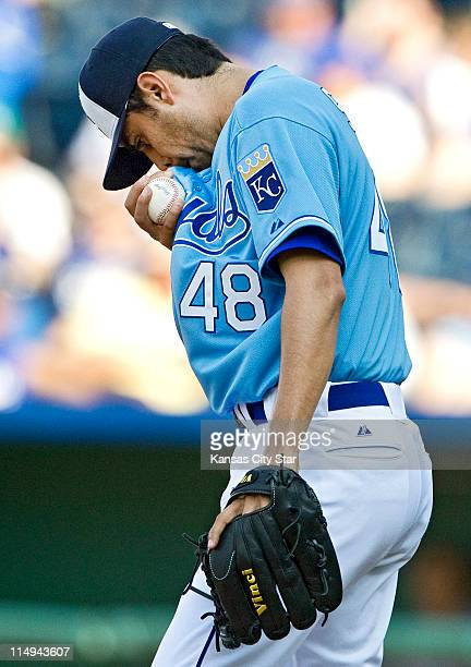 Kansas City Royals relief pitcher Joakim Soria wipes his face as he prepares to continue pitching after giving up an RBI single to Los Angeles...