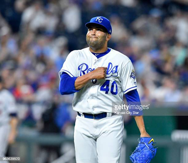 Kansas City Royals relief pitcher Kelvin Herrera pumps his chest after getting Minnesota Twins' Brian Dozier to hit a fly ball out to end the top of...