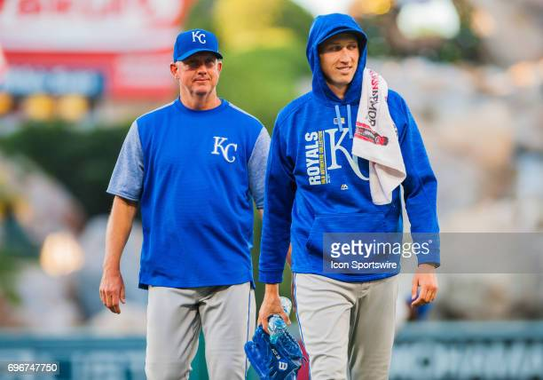 Kansas City Royals relief pitcher Matt Strahm on the right walks back to the dugout prior to the regular season game between the Los Angeles Angels...