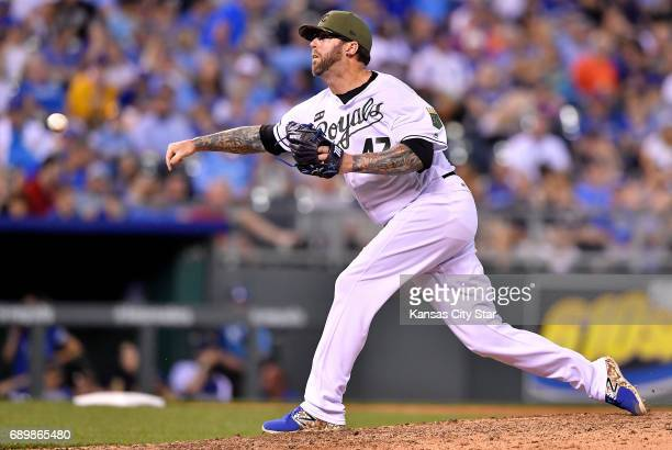 Kansas City Royals relief pitcher Peter Moylan throws in the seventh inning against the Detroit Tigers on Monday May 29 2017 at Kauffman Stadium in...