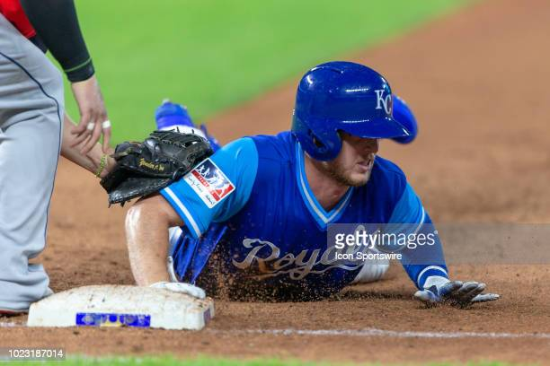 Kansas City Royals right fielder Brett Phillips dives back to first base during the MLB game against the Cleveland Indians on August 24 2018 at...
