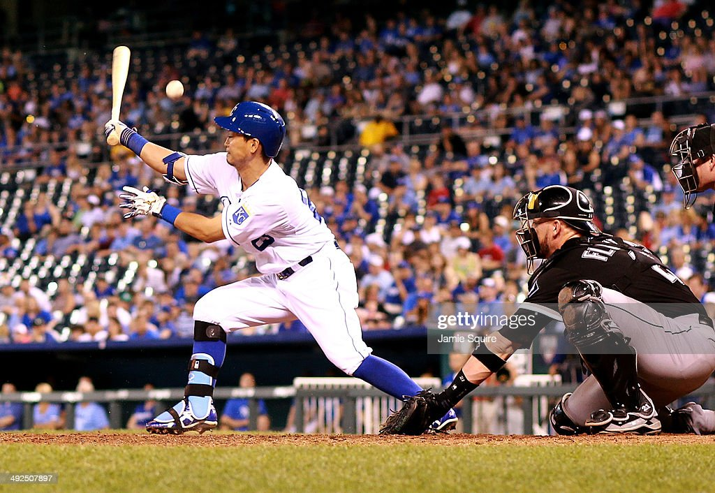 Kansas City Royals right fielder Norichika Aoki #23 hits foul during the 8th inning of the game against the Chicago White Sox at Kauffman Stadium on May 20, 2014 in Kansas City, Missouri.
