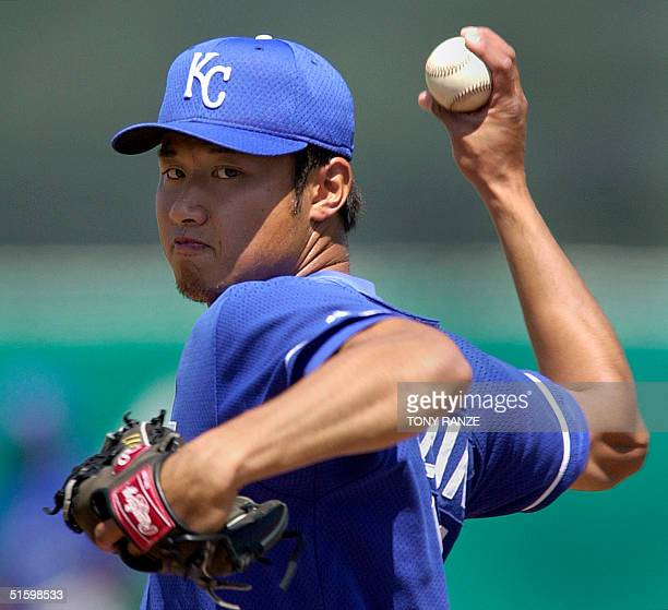 Kansas City Royals' righthanded pitcher Mac Suzuki of Kobe Japan throws from the mound during the first inning of a spring training game with the...