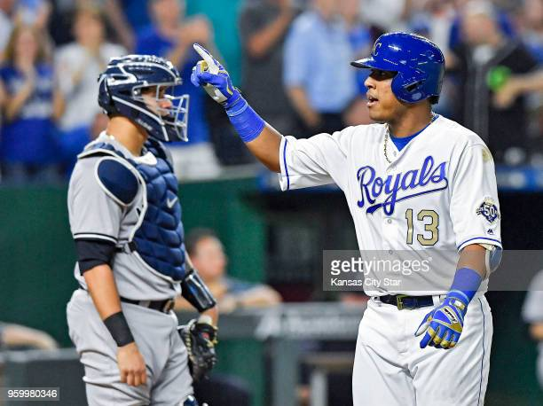 Kansas City Royals' Salvador Perez celebrates his solo home run in front of New York Yankees catcher Gary Sanchez in the fifth inning during Friday's...