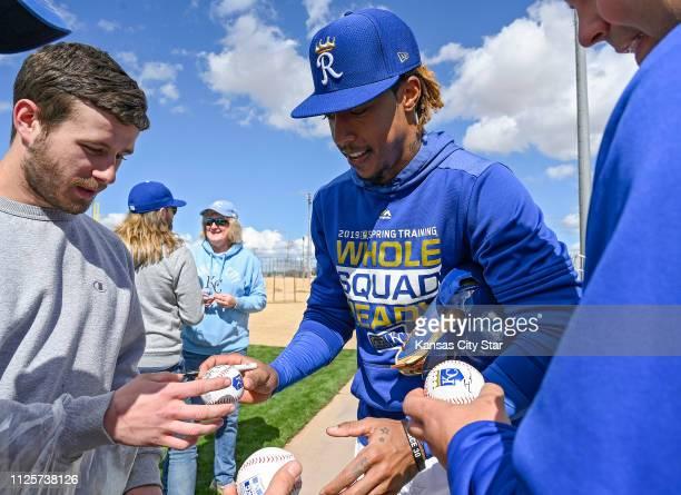 Kansas City Royals second baseman Adalberto Mondesi autographs baseball after Monday's spring training workout on Feb 18 2019 in Surprise Ariz