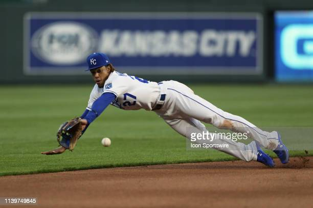 Kansas City Royals second baseman Adalberto Mondesi makes a diving stop on a ground ball from Los Angeles Angels shortstop Andrelton Simmons in the...