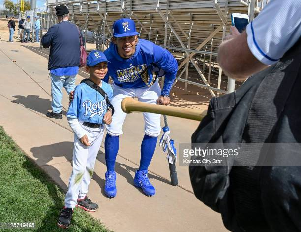 Kansas City Royals second baseman Adalberto Mondesi stops to have his picture taken with 7yearold Joel Gardner by his father Tony Gardner Monday Feb...