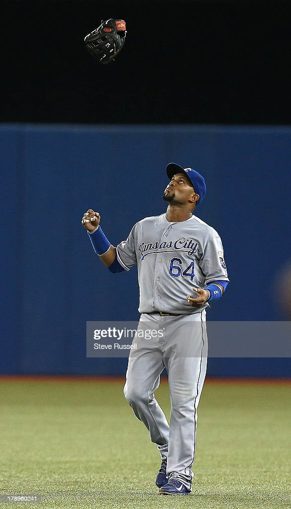 TORONTO, ON- AUGUST 31 - Kansas City Royals second baseman Emilio Bonifacio tosses his glove up in the air after failing to track down a Jose Reyes' bloop single in the seventh inning as Toronto Blue Jays beat the Kansas City Royals 4-2 in MLB action at Rogers Centre in Toronto, August 31, 2013.
