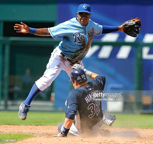 Kansas City Royals second baseman Esteban German forces out Tampa Bay Rays' Eric Hinske and completes the double play on Shawn Riggans in the ninth...