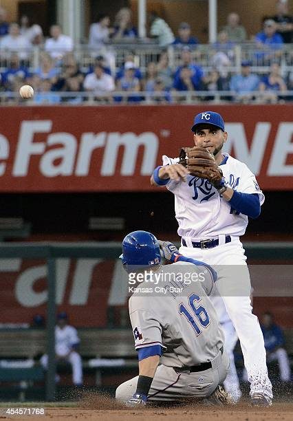 Kansas City Royals second baseman Omar Infante forces the Texas Rangers' Ryan Rua out at second but couldn't complete the double play on the Rangers'...