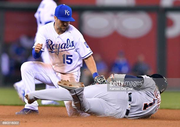 Kansas City Royals second baseman Whit Merrifield tags out the Detroit Tigers' Jose Iglesias trying to steal second to end the top of the eighth...