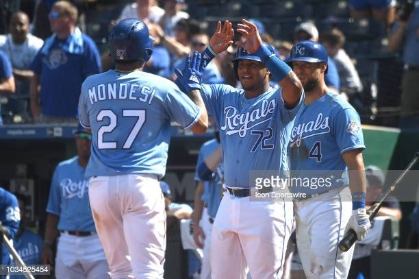 Kansas City Royals shortstop Adalberto Mondesi is congratulated at the plate after his home run during a MLB game between the Minnesota Twins and the...