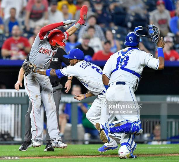 Kansas City Royals shortstop Alcides Escobar misses the rundown tag on the Cincinnati Reds' Billy Hamilton left in the 10th inning allowing Hamilton...