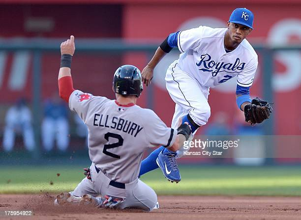 Kansas City Royals shortstop Alcides Escobar right forces out Jacoby Ellsbury of the Boston Red Sox at second base on a grounder by Shane Victorino...
