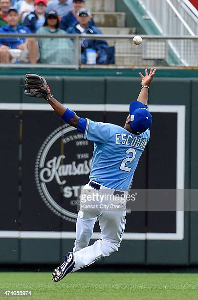 Kansas City Royals shortstop Alcides Escobar tried to bare hand a two RBI single by St. Louis Cardinals' Yadier Molina that scored Jhonny Peralta and...