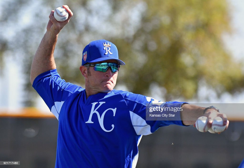 Kansas City Royals special assistant to the general manager Mike Sweeney throws batting practice during a spring training workout on Tuesday, Feb. 20, 2018, in Surprise, Ariz.