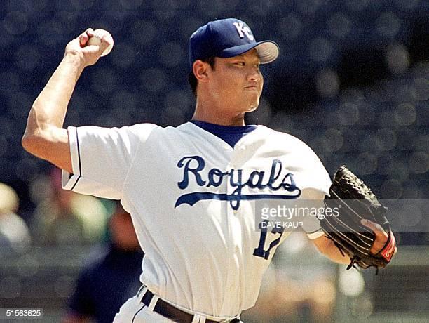 Kansas City Royals starting pitcher Mac Suzuki fires a pitch against Minnesota Twins Denny Hocking 30 August 2000 at Kauffman Stadium in Kansas City...