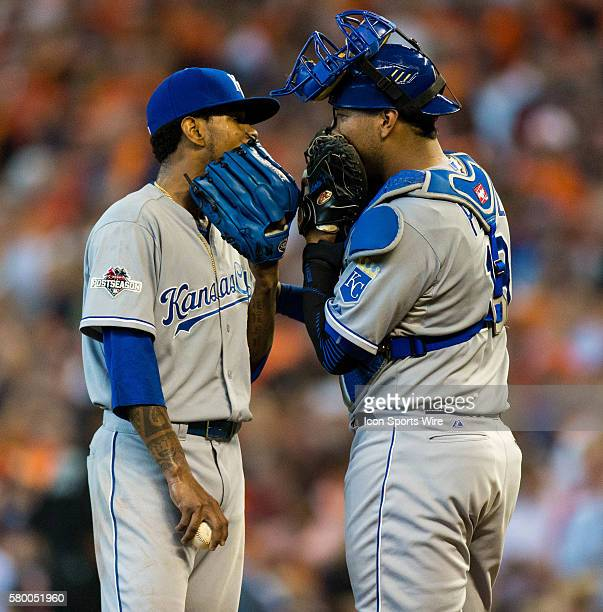 Kansas City Royals starting pitcher Yordano Ventura and Kansas City Royals catcher Salvador Perez with the gloves over their mouth while talking to...