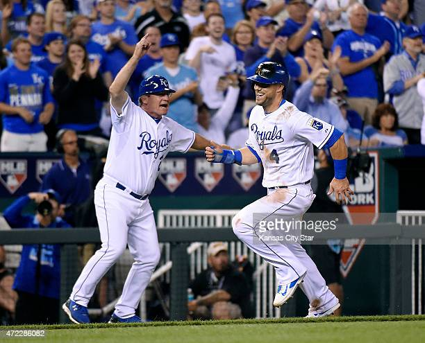 Kansas City Royals third base coach Mike Jirschele waves Alex Gordon home on a triple by Eric Hosmer in the eighth inning against the Cleveland...