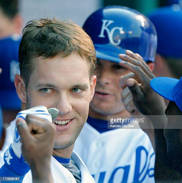 Kansas City Royals third baseman Alex Gordon is congratulated in the dugout after hitting a tworun home run in the second inning that also scored...