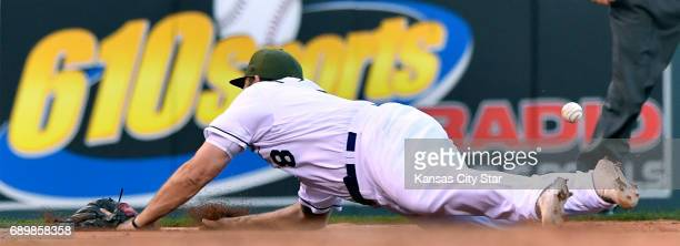 Kansas City Royals third baseman Mike Moustakas couldn't stop a tworun double by Detroit Tigers' Victor Martinez in the fifth inning on Monday May 29...