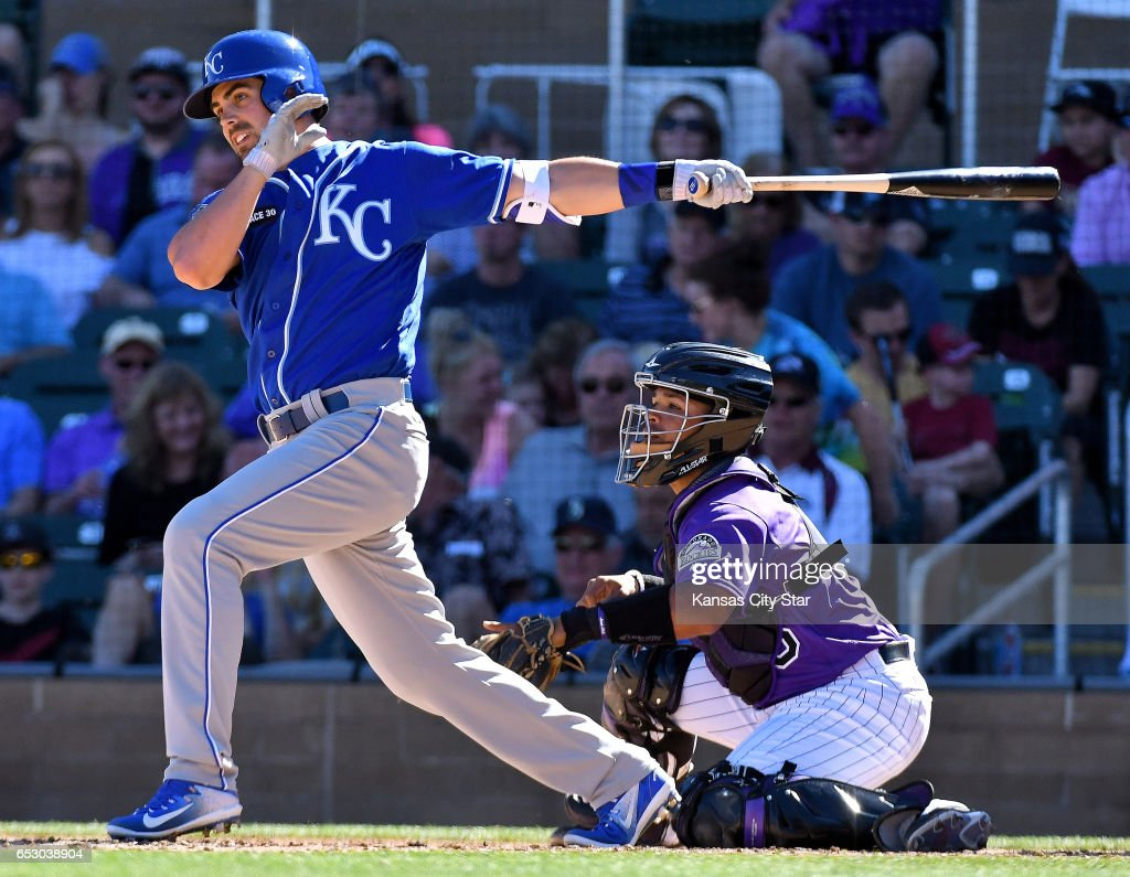 Kansas City Royals' Whit Merrifield connects on a single in the seventh inning against the Colorado Rockies during a spring training baseball game on Monday, March 13, 2017 in Scottsdale, Ariz.