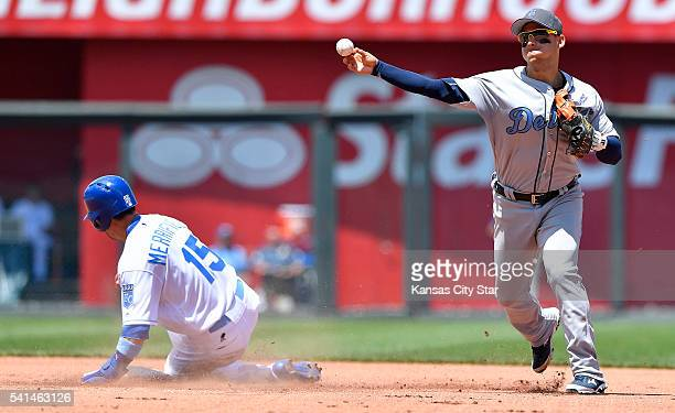 Kansas City Royals' Whit Merrifield is forced out by Detroit Tigers shortstop Jose Iglesias before completing the double play on Alcides Escobar...