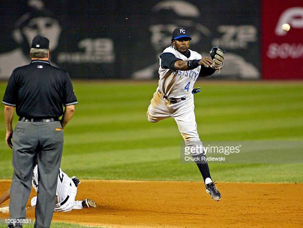 Kansas City shortstop Angel Berroa turns a double play as the Kansas City Royals play the the Chicago White Sox at U.S. Cellular Field in Chicago,...