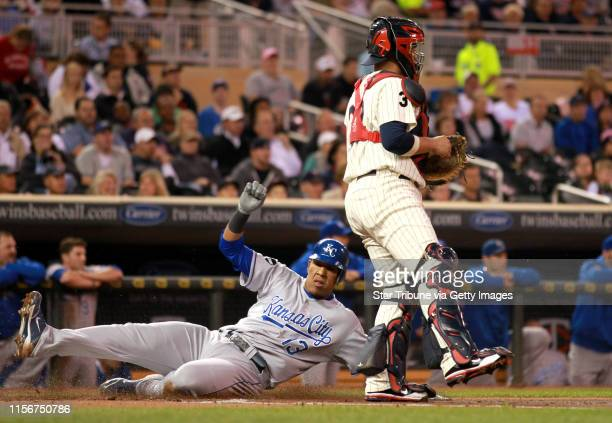 Kansas City's catcher Salvador Perez scored in the second inning as he slide past Twins catcher Rene Rivera during Tuesday night MLB action between...