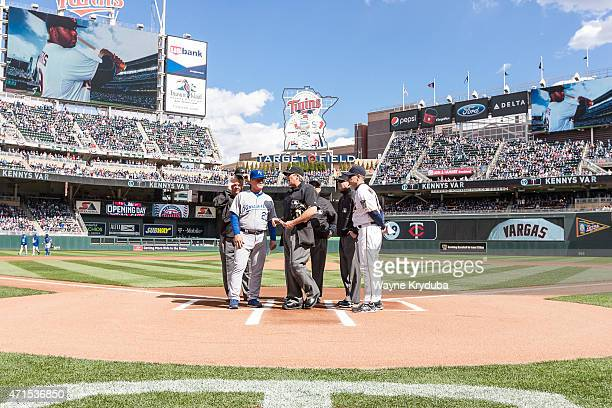 Kansas City's Mike Jirschele Minnesota Twins Paul Molitor and umpires Joe West Dana DeMuth and Mike Estabrook look on as Paul Nauert explains the...