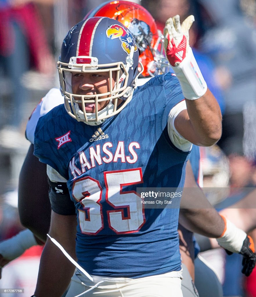 Kansas defensive end Anthony Olobia (35) celebrates a sack in the third quarter against Oklahoma State at Memorial Stadium in Lawrence, Kan., on Saturday, Oct. 22, 2016. Oklahoma State won, 44-20.