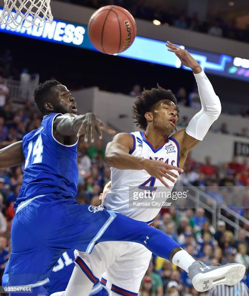 Kansas' Devonte' Graham loses control of the ball while driving to the basket against Seton Hall's Ismael Sanogo during the first half in the second...