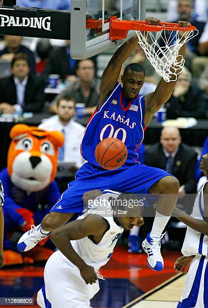 Kansas forward Darrell Arthur dunks over Memphis forward Joey Dorsey during first half action in the NCAA Men's Basketball Championship game at the...